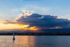 Sunset on lake of Geneva. Beautiful view of sunset on the lake of Geneva and the cityscape of Geneva as silhouette, Switzerland Stock Photo