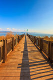 Sunset on the lake of Kinneret. Wooden pier leading to the famous Sea of Galilee. Sunset on the lake of Kinneret Royalty Free Stock Photography