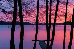 Sunset on a lake landscape with trees Royalty Free Stock Image