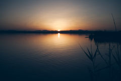 Sunset on a lake. Late evening landscape. No wind, quiet. Still water Stock Photo