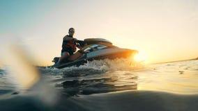 Sunset lake with a man jet-skiing. Waverunner riding.