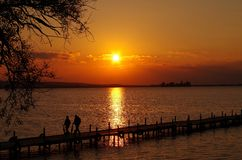Sunset at the lake me people Stock Image