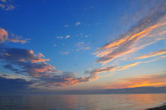 Sunset on Lake Michigan. On the beach at Ludington State Park with clouds royalty free stock photography