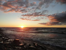 Sunset at lake Ontario in Oswego, NY Stock Photos