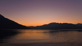 Sunset on the lake, with orange sky royalty free stock images