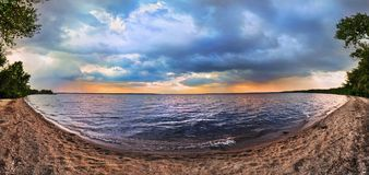 Sunset on the lake. Panorama Stock Images