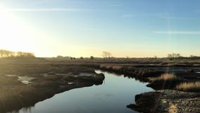 Sunset on a lake. Panoramic view of sunset on Ria de Aveiro, Ovar, Portugal stock video