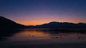 Sunset on the lake, with pink and violet sky. In january stock image