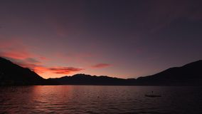 Sunset on the lake, with red and pink clouds royalty free stock photos