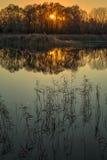 Sunset on lake reflection Royalty Free Stock Images