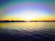 Sunset on lake ripples water. Sunset beautiful colorful sky on lake ripples water Royalty Free Stock Images