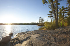 Sunset on lake with rocky shore in northern Minnesota Royalty Free Stock Image