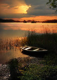 Sunset lake with rowing boat Royalty Free Stock Photography