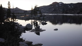 Sunset and Lake in Sierra Nevada Mountains, California stock video footage