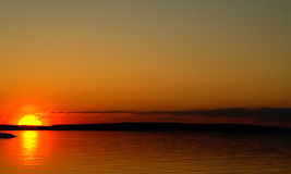 Sunset on a lake and the silouette of gull. Red sunset on a lake and the gull silouette Stock Photo