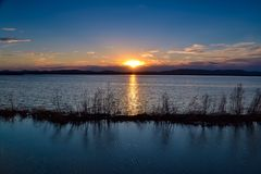 Sunset lake. Sunset on the lake in the spring Royalty Free Stock Image