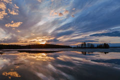 Sunset on the lake. Spring, Karelia. Elm lake Stock Photos
