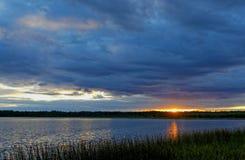 Sunset on the lake taiga Stock Image