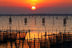 Sunset. On the lake with Thailand fishing net Royalty Free Stock Photography