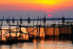 Sunset. On the lake with Thailand fishing net Stock Photo