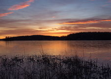 Sunset. At a lake with thin ice and a beautiful sky Stock Photography