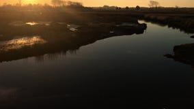 Sunset on a lake. Tilt view of sunset on Ria de Aveiro, Ovar, Portugal stock footage