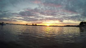 Sunset on the lake, time-lapse. Evening sunset on the lake, time-lapse stock footage