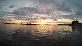 Sunset on the lake, time-lapse. Evening sunset on the lake, time-lapse stock video footage