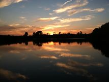 Sunset on the lake trees. Beautiful sunset on a quiet lake Royalty Free Stock Photography