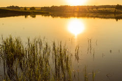 Sunset on the lake. Two banks Stock Photography