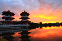 Sunset in a Lake with Two Pagoda Royalty Free Stock Image