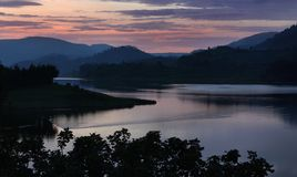 Sunset on a lake in Uganda, Africa. Twilight on the quiet lake Bunyonyi, Uganda stock photos
