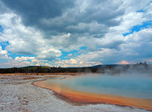 Sunset Lake under cumulus clouds in Black Sand Basin in Yellowstone National Park in Wyoming USA Royalty Free Stock Images