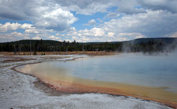 Sunset Lake under dark cumulus clouds in Black Sand Basin in Yellowstone National Park in Wyoming USA Stock Photography