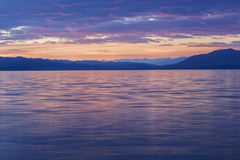Sunset on lake Stock Images
