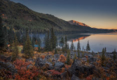 Sunset Lake View With Calm Water And Evergreen Forest On The Shore, Altai Mountains Highland Nature Autumn Landscape Royalty Free Stock Photography