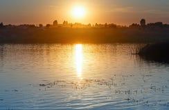 Sunset lake view. Stock Photos