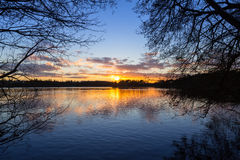 Sunset at the lake in winter Stock Photo