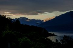 A sunset with lakes and mountains in New Zealand stock photo