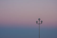 Sunset with a lamppost stock photos