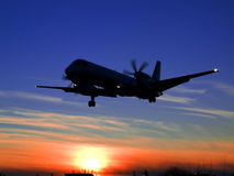Sunset Landing. Saab 2000 landing at Cluj Napoca Intl Airport Royalty Free Stock Images