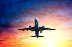 Sunset landing. Bottom plane in the sunset vector illustration