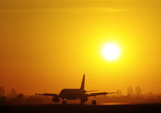 Sunset landing. Plane landed at the airport during sunset Royalty Free Stock Images