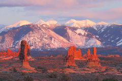 Sunset Landscape. Petrified sand dunes with the La Sal Mountains in the background in Arches National Park near Moab, Utah Royalty Free Stock Photo