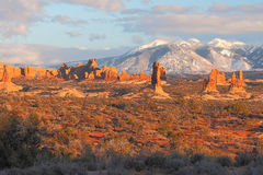 Sunset Landscape. Petrified sand dunes with the La Sal Mountains in the background in Arches National Park near Moab, Utah royalty free stock image