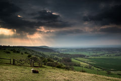 Sunset landscape across English countryside with dramatic sky Royalty Free Stock Images