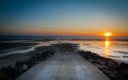 Sunset landscape on the beach during low tide Royalty Free Stock Photos