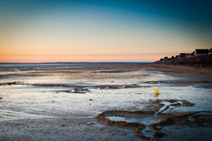 Sunset landscape on the beach during low tide Stock Photo