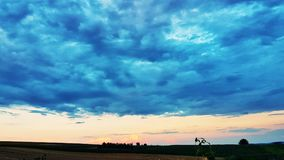 Sunset landscape. With blue clouds Royalty Free Stock Photo