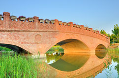 Sunset landscape with brick arch bridge. On the river,China Stock Photos
